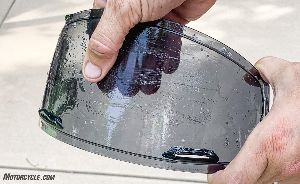 How do you remove scratches from helmet visors at home?