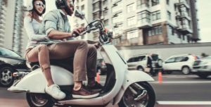 Why are the two wheels on motorcycles different in size?