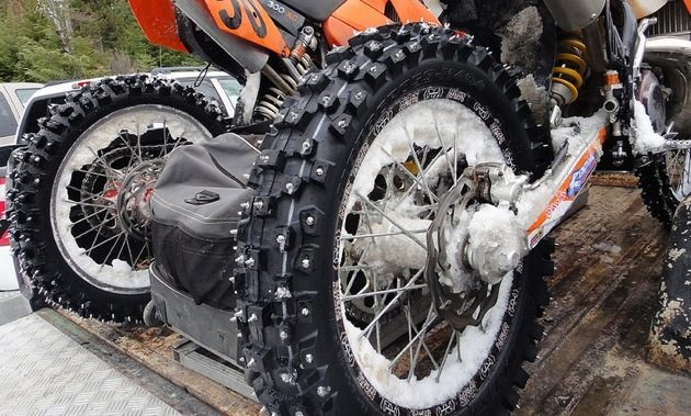 How do you clean debris off motorcycle tires?